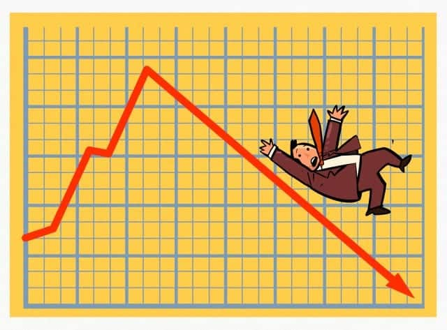 Businessman sliding down a stock chart arrow